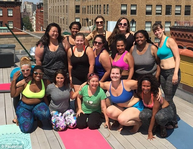 feel the burn: Dana can be seen striking a pose with her fellow yogis after a rooftop yoga class