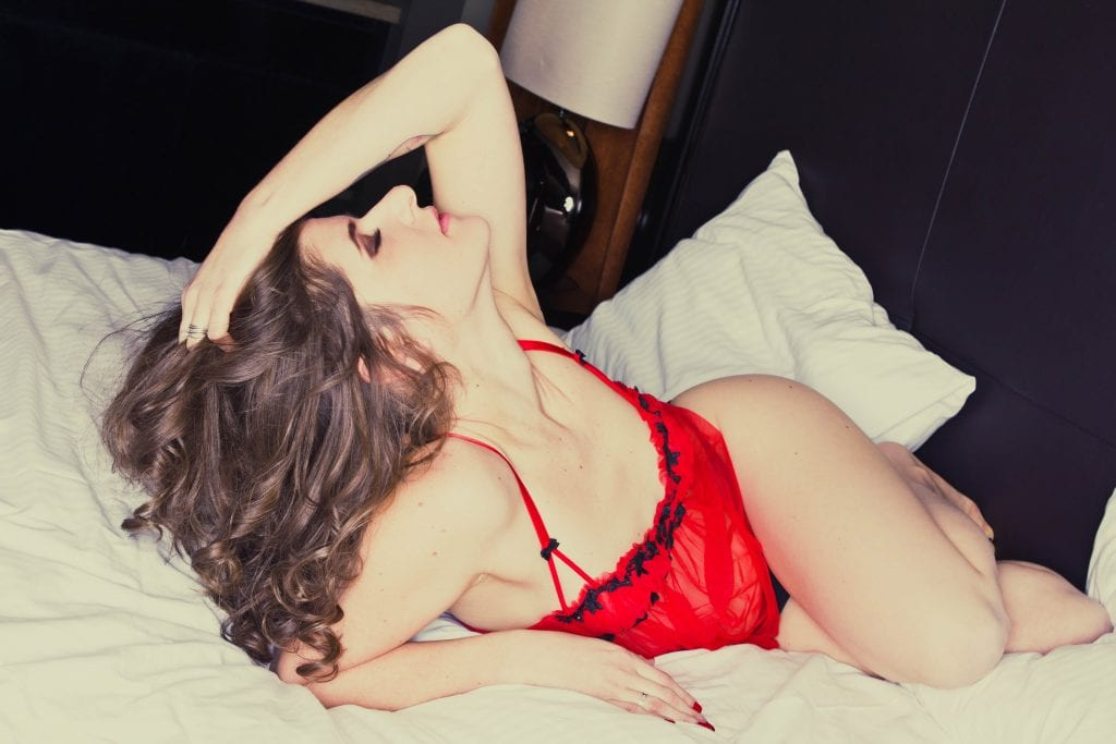 Ms. M is rocking her boudoir photography session at Hotel Arts in Calgary Alberta